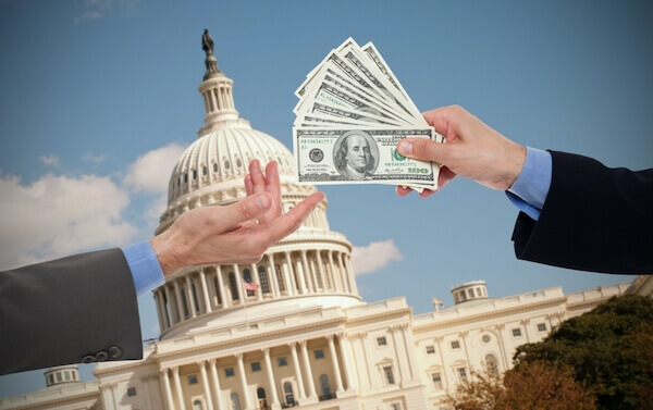 money changing hands in front of the capitol building